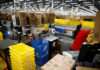 © Reuters. Employee Jimenez works at a packing station at the Amazon fulfillment center in Kent