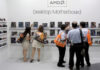 © Reuters. FILE PHOTO: Visitors look at motherboards being displayed at the AMD booth during the 2012 Computex exhibition at the TWTC Nangang exhibition hall in Taipei