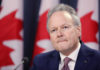 © Reuters. Bank of Canada Governor Stephen Poloz listens to a question during a news conference in Ottawa