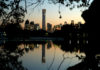 © Reuters. The cityscape of the Beijing Central Business District is reflected in a pond during sunset