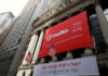 © Reuters. A banner for communications software provider Twilio Inc., hangs on the facade at the NYSE to celebrate the company