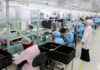 © Reuters. Women work on a production line at the mobile phone factory in Assuit