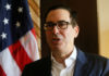 © Reuters. United States Secretary of the Treasury Steven Mnuchin speaks during an interview with Reuters at the International Monetary Fund - World Bank Annual Meeting 2018 in Nusa Dua