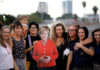 © Reuters. A group of working women in the Israeli high-tech industry pose with a cardboard cutout of German Chancellor Angela Merkel during a protest at Rabin Square in Tel Aviv