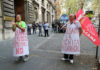 © Reuters. People wearing signs protest in front of the Italian Ministry of Labour office in Rome
