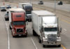 © Reuters. FILE PHOTO: Two freight trucks are driven on the Fisher freeway in Detroit, Michigan