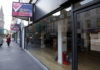 © Reuters. FILE PHOTO: Vacant shops are seen in High Street, Perth