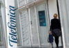 © Reuters. FILE PHOTO: A woman walks into a Telefonica office building in Barcelona
