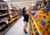 © Reuters. Walmart department manager Karren Gomes helps stock shelves with school supplies as the retail store prepare for back to school shoppers in San Diego, California