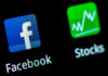 © Reuters. FILE PHOTO: A Facebook application logo is pictured on a mobile phone in this photo illustration taken in Lavigny