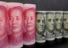 © Reuters. FILE PHOTO:  U.S. 100 dollar banknotes and Chinese 100 yuan banknotes are seen in this picture illustration in Beijing