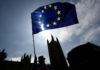© Reuters. An anti-Brexit protester waves an EU flag opposite the Houses of Parliament in London