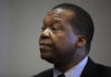 © Reuters. FILE PHOTO: Reserve Bank of Zimbabwe Governor John Mangudya listens to questions during an interview in Harare
