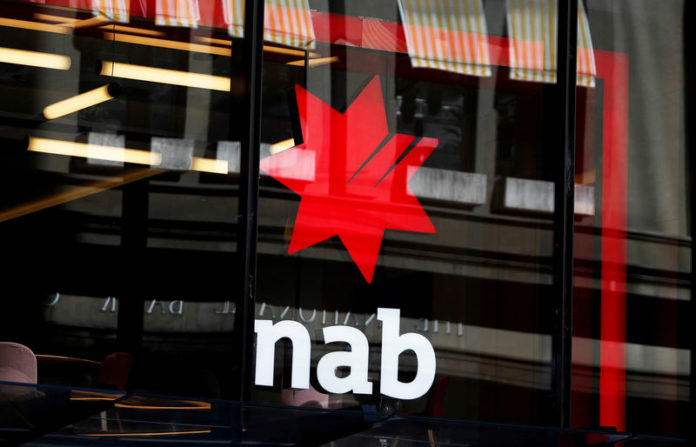 © Reuters. FILE PHOTO: The National Australia Bank logo is seen on a branch in central Sydney