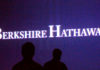 © Reuters. FILE PHOTO: File photo of Berkshire Hathaway shareholders walking by a video screen at the company