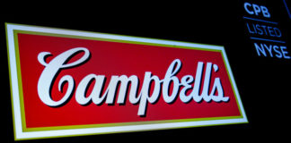 © Reuters. FILE PHOTO: The logo and ticker for Campbell Soup Co. are displayed on a screen on the floor of the NYSE in New York