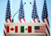 © Reuters. FILE PHOTO: The flags of Canada Mexico and the U.S. are seen on a lectern before a joint news conference of NAFTA talks in Mexico City