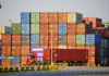 © Reuters. Truck transports a shipping container at Qingdao port in Shandong