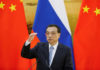 © Reuters. Chinese Premier Li Keqiang attends a joint news conference with Russian Prime Minister Dmitry Medvedev (not pictured) at the Great Hall of the People in Beijing