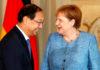 © Reuters. FILE PHOTO - German Chancellor Angela Merkel receives diplomatic corps