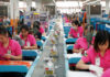 © Reuters. Employees work at a production line assembling scale models of the moon rover for China