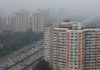 © Reuters. Residential buildings are seen along the Fourth Ring Road in Beijing