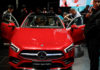 © Reuters. People attend a world premiere for new Mercedes Benz A-Class L Sedan in Beijing