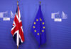 © Reuters. British and EU flags are seen before Britain