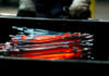 © Reuters. FILE PHOTO - Unfinished pliers still glow after being hot-formed by a hammer at the factory of Knipex in Wuppertal