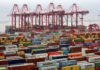 © Reuters. FILE PHOTO: Containers are seen at the Yangshan Deep Water Port in Shanghai