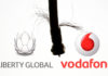 © Reuters. Coaxial TV Cable is seen in front of Vodafone and Liberty Global logos in this illustration
