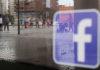 © Reuters. Facebook logo is seen on a shop window in Malaga