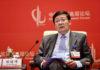 © Reuters. Lou Jiwei speaks at the China Development Forum in Beijing