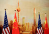 © Reuters. FILE PHOTO: U.S. and Chinese flags are placed for a joint news conference in Beijing