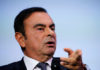 © Reuters. FILE PHOTO: Carlos Ghosn, chairman and CEO of the Renault-Nissan-Mitsubishi Alliance, speaks at the Tomorrow In Motion event on the eve of press day at the Paris Auto Show, in Paris