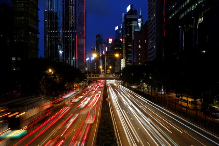 © Reuters. Traffic is seen between office buildings in downtown Hong Kong