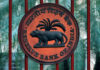 © Reuters. FILE PHOTO: Reserve Bank of India logo is seen at the gate of its office in New Delhi