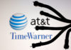 © Reuters. Coaxial TV Cables are seen in front of AT&T and Time Warner logos in this picture illustration