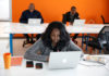 © Reuters. An employee of tech start-up Sendy, which offers online logistics services, works on her computer at their office in Nairobi