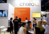 © Reuters. Members of staff work at the Criteo booth during Global Mobile Internet Conference (GMIC) at the National Convention in Beijing