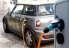 © Reuters. FILE PHOTO: A BMW Mini electric car is charged at a station downtown Munich