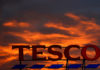 © Reuters. FILE PHOTO: A company logo is pictured outside a Tesco  supermarket in Altrincham northern England.