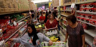 © Reuters. People visit Big C center while shopping in Bangkok