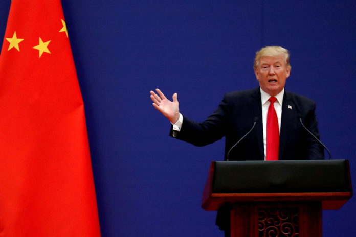 © Reuters. FILE PHOTO: U.S. President Donald Trump delivers his speech as he and China