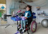 © Reuters. Eight-year-old Victoria Gusset sits in her wheelchair as she plays in her room at home in Heimbach