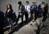 © Reuters. People wait in line to attend TechFair LA, a technology job fair, in Los Angeles