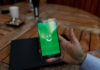 © Reuters. FILE PHOTO: Employee shows the logo of Careem on his mobile in his office in the West Bank city of Ramallah