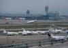 © Reuters. Business jets park at Hong Kong International Airport