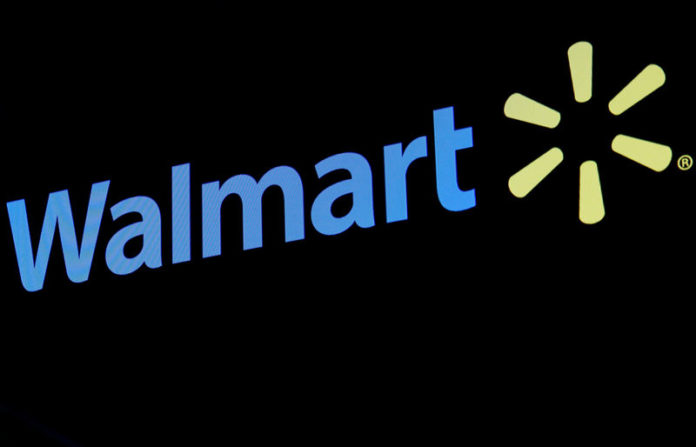 © Reuters. FILE PHOTO: The Walmart logo is displayed on a screen on the floor of the NYSE in New York