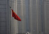 © Reuters. FILE PHOTO: A Chinese flag is seen in front of the financial district of Pudong in Shanghai